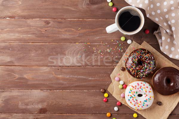 Fánkok kávé fa asztal felső kilátás copy space Stock fotó © karandaev