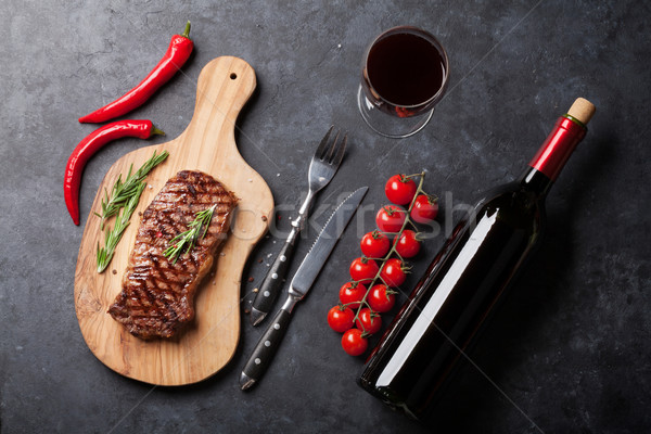 Grilled striploin steak and wine Stock photo © karandaev