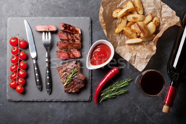 Grilled striploin steak and red wine Stock photo © karandaev