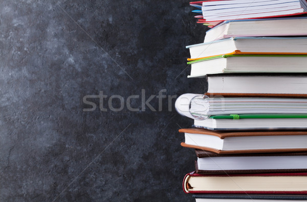 Notepads in front of chalk board Stock photo © karandaev