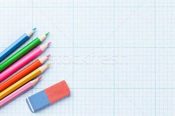 Colorful pencils over paper Stock photo © karandaev