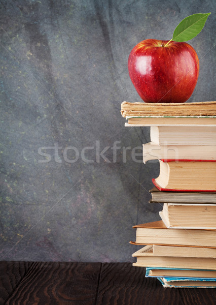 Books and apple in front of classroom chalk board Stock photo © karandaev