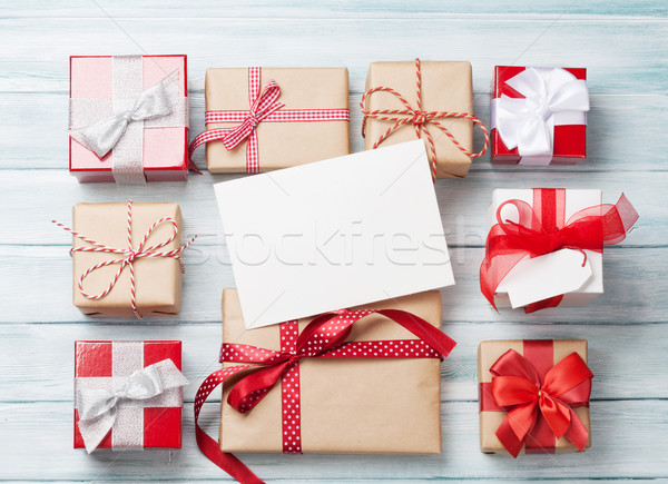 Hediye kutuları Noel tebrik kartı ahşap masa üst görmek Stok fotoğraf © karandaev