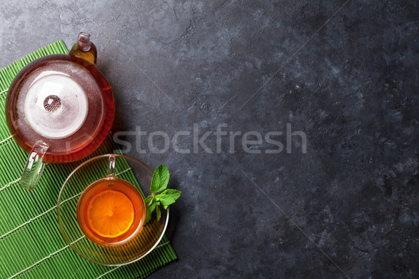 Tea cup and teapot Stock photo © karandaev