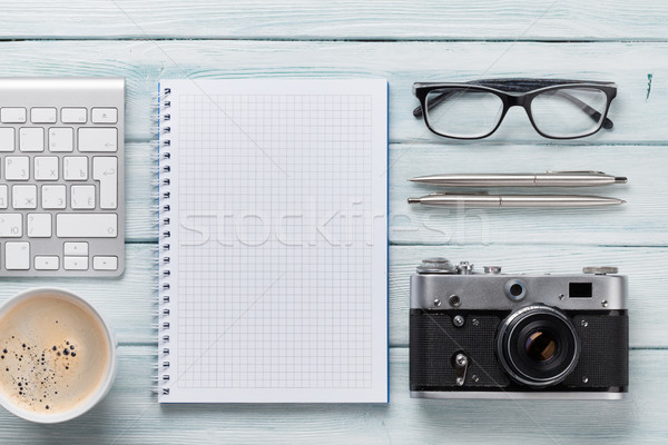 Wooden desk with camera, pc and notepad Stock photo © karandaev