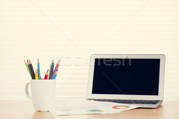 Office workplace with laptop, reports and pencils Stock photo © karandaev