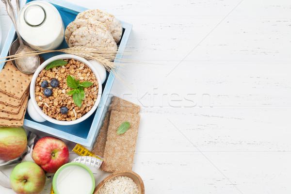 Sağlıklı kahvaltı ayarlamak müsli karpuzu süt Stok fotoğraf © karandaev