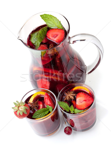 Refreshing fruit sangria in jug and two glasses Stock photo © karandaev