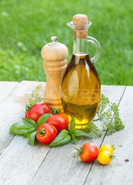 Olívaolaj üveg bors shaker paradicsomok gyógynövények Stock fotó © karandaev