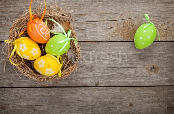пасхальных яиц гнезда деревянный стол природы краской фон Сток-фото © karandaev