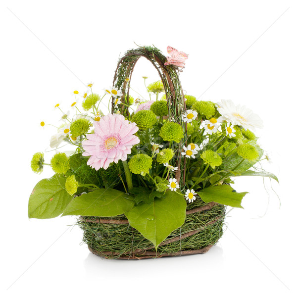 Bouquet of flowers in basket with butterfly Stock photo © karandaev