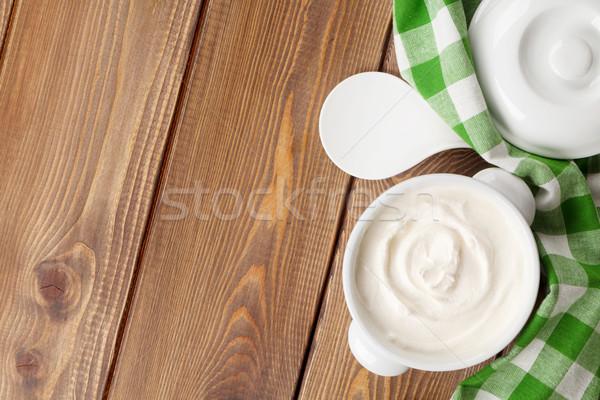 Photo stock: Crème · bol · table · en · bois · haut · vue · espace · de · copie