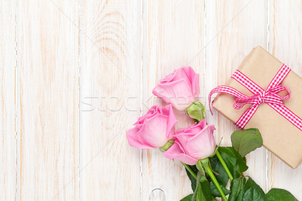 Valentines day background with pink roses over wooden table and  Stock photo © karandaev