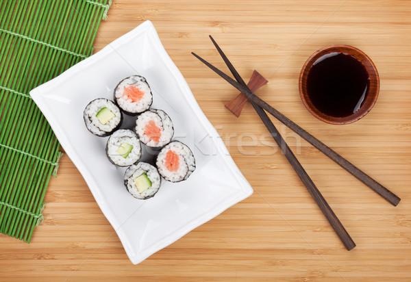Sushi ayarlamak Çin yemek çubukları soya sosu bambu tablo Stok fotoğraf © karandaev