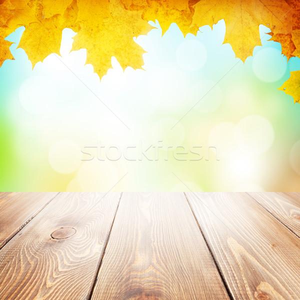 Herbst Natur Ahorn Blätter Holztisch verschwommen Stock foto © karandaev