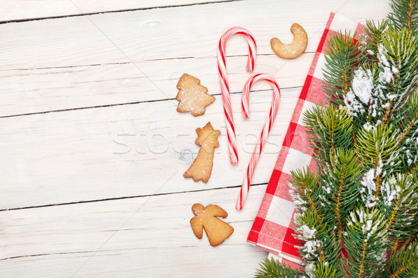 Christmas candy cane, gingerbread cookies and snow fir tree Stock photo © karandaev