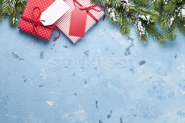 Karácsony ajándékdobozok fenyőfa kő asztal felső Stock fotó © karandaev