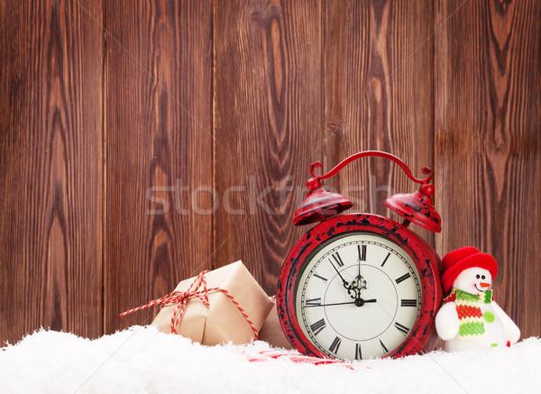 Christmas gift box, snowman toy and alarm clock Stock photo © karandaev