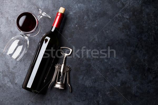 Red wine glasses and bottle Stock photo © karandaev
