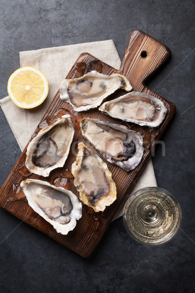 Oysters with lemon and white wine Stock photo © karandaev