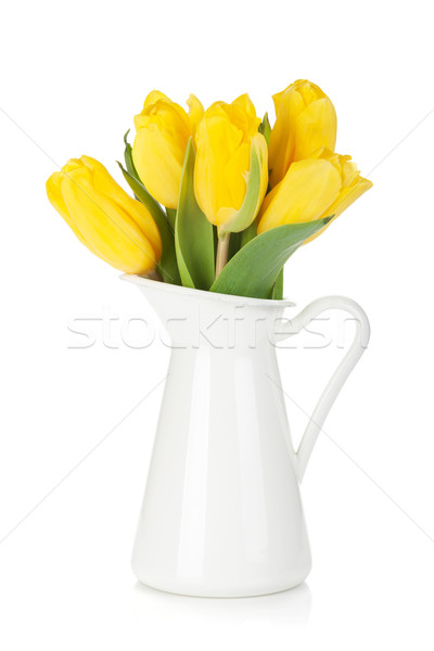 Yellow tulips in a jug Stock photo © karandaev