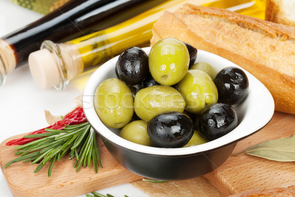 Italian food appetizer of olives, bread and spices Stock photo © karandaev