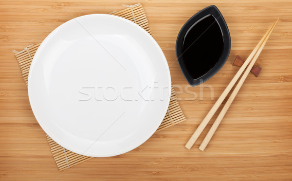 Empty plate, sushi chopsticks and soy sauce Stock photo © karandaev