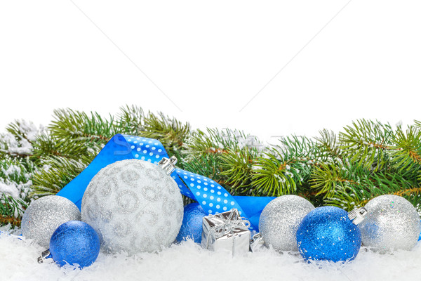 Christmas baubles and blue ribbon with snow fir tree Stock photo © karandaev