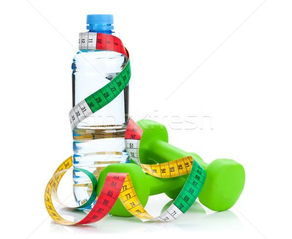 Deux vert mètre à ruban une bouteille d'eau fitness santé Photo stock © karandaev