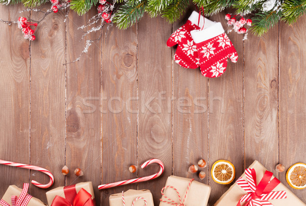 Christmas background with fir tree and gift boxes Stock photo © karandaev