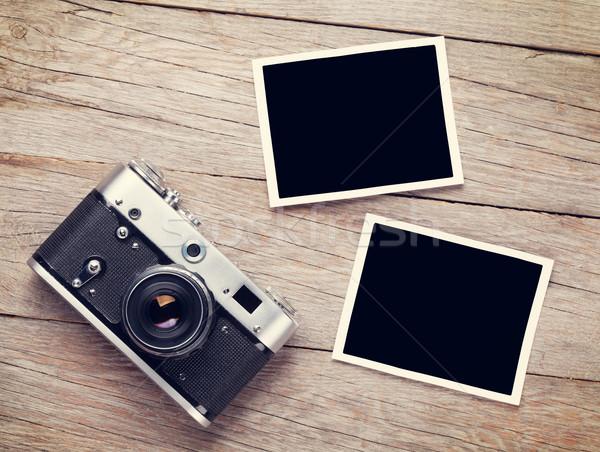 Vintage film camera and two blank photo frames Stock photo © karandaev