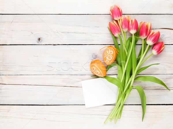 Színes tulipánok húsvéti tojások üdvözlőlap tulipán virágcsokor Stock fotó © karandaev