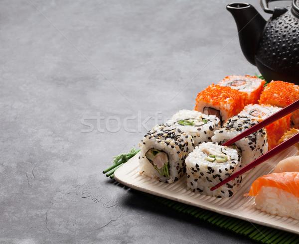 Ingesteld sushi maki rollen groene thee steen Stockfoto © karandaev