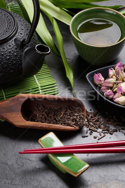 ázsiai rózsa tea teáskanna kő asztal Stock fotó © karandaev