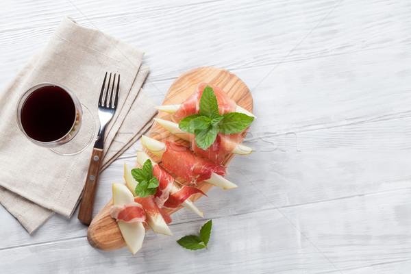 Dinnye prosciutto menta friss antipasti vörösbor Stock fotó © karandaev