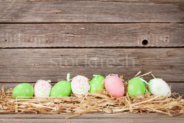 Easter eggs legno muro spazio Pasqua legno Foto d'archivio © karandaev
