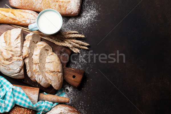 Various crusty bread and cup of milk Stock photo © karandaev
