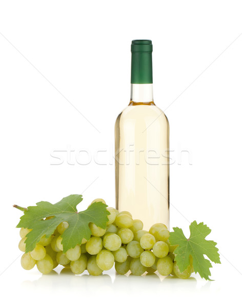 Stock photo: White wine bottle and grapes
