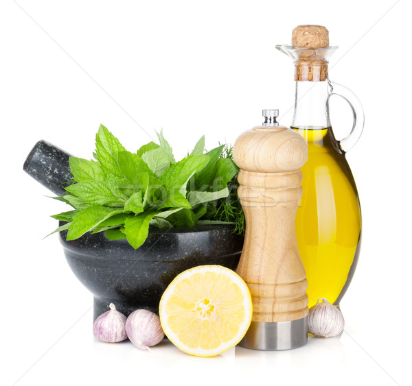 Stock photo: Fresh herbs, olive oil and pepper shaker