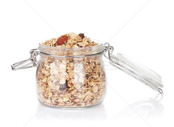 Vetro jar muesli isolato bianco mangiare Foto d'archivio © karandaev