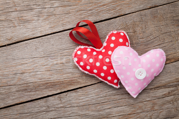 Valentines day toy hearts over wooden table background Stock photo © karandaev