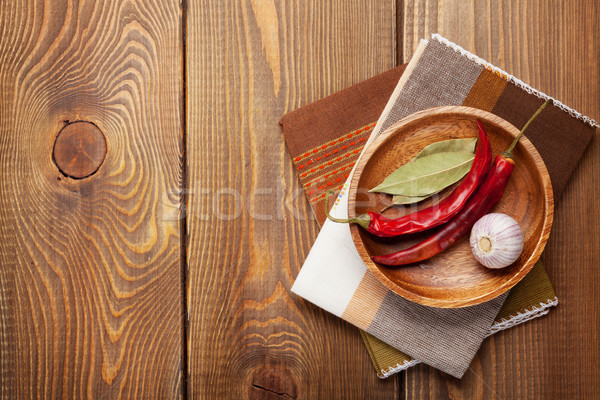 Wood kitchen utensils and spices over wooden table Stock photo © karandaev