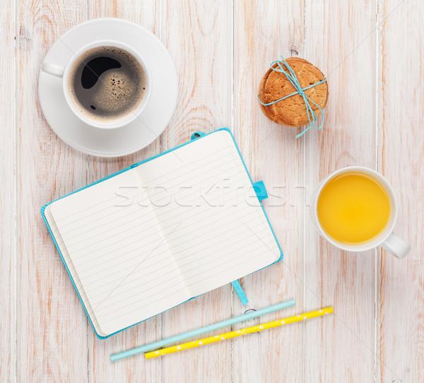 Cup of orange juice, coffee cup, gingerbread cookies and notepad Stock photo © karandaev