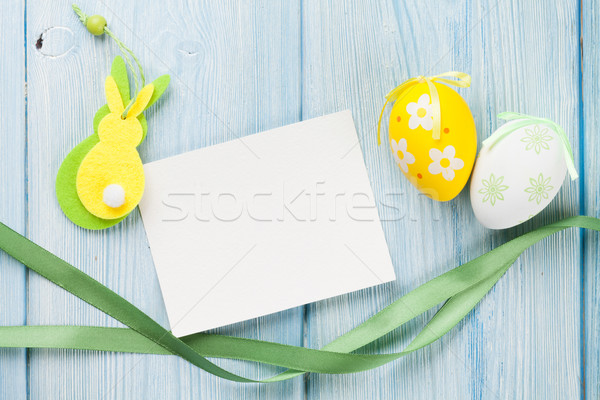 Húsvét üdvözlőlap tojások dekoráció kék fa asztal Stock fotó © karandaev