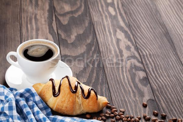 Taze kruvasan kahve ahşap masa görmek bo Stok fotoğraf © karandaev