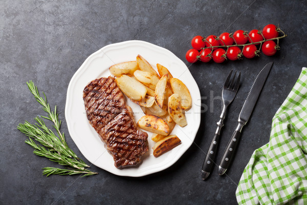 Grilled striploin steak and roasted potato Stock photo © karandaev