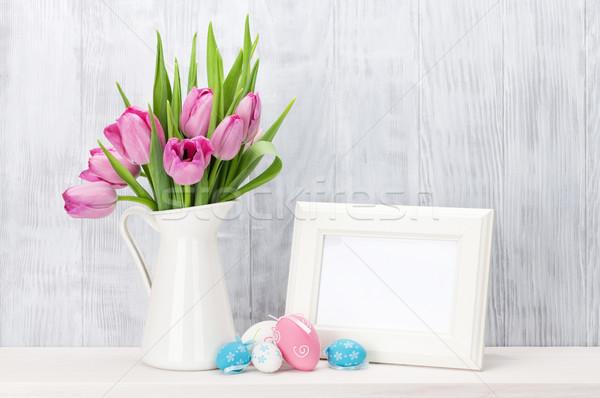 Húsvéti tojások fényképkeret rózsaszín tulipánok virágcsokor polc Stock fotó © karandaev