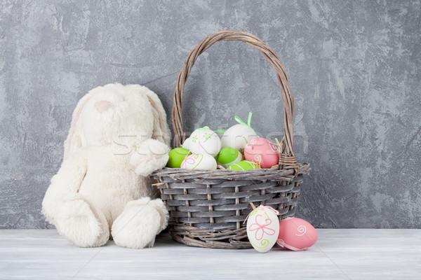 Nyúl játék húsvéti tojások kosár kőfal húsvét Stock fotó © karandaev