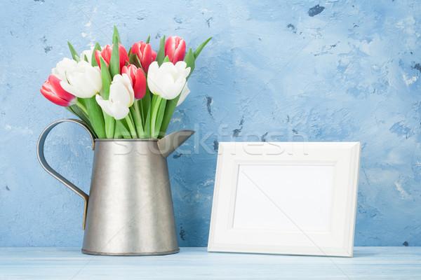 Fresh tulip flowers bouquet and photo frame Stock photo © karandaev