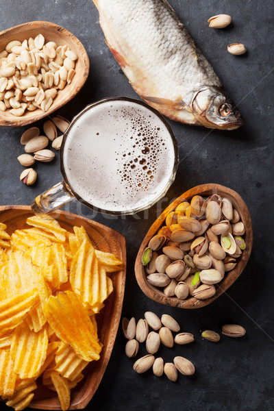 Lager beer and snacks on stone table Stock photo © karandaev
